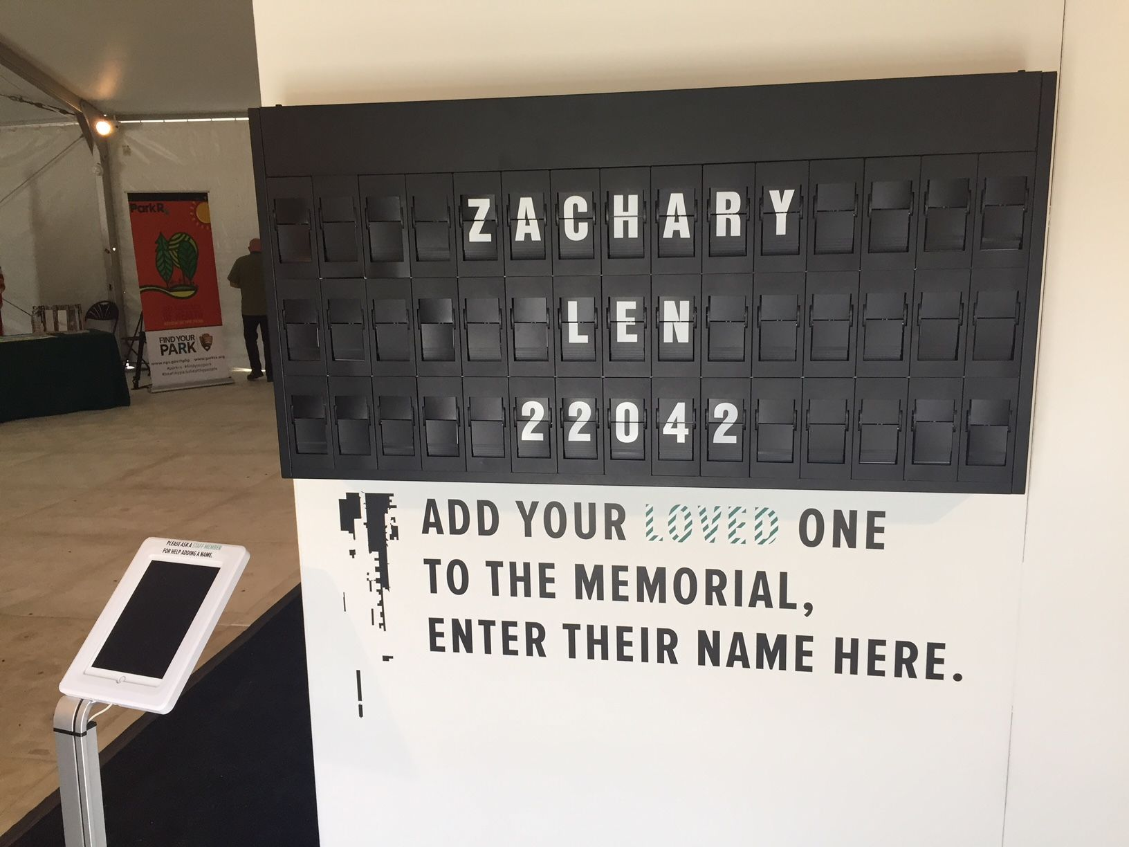At the end of the memorial is a board that lets you remember anyone you know who died from an overdose.  Every few seconds a new name, with another number, is shown (Photo by John Domen).