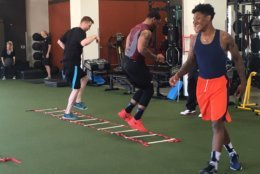 Jessop trains at OneLife Fitness in Brambleton with other athletes including Nigel Johnson (right), who played on the Virginia basketball team as a graduate transfer this season and is looking to improve before the NBA Draft, and Deon Clarke, a former Virginia Tech linebacker who latched onto the Seattle Seahawks practice squad. (WTOP/Noah Frank)
