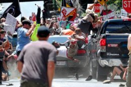FILE - In this Aug. 12, 2017, photo by Ryan Kelly of The Daily Progress, people fly into the air as a car drives into a group of protesters demonstrating against a white nationalist rally in Charlottesville, Va. The photo won the 2018 Pulitzer Prize for Breaking News Photography, announced Monday, April 16, 2018, at Columbia University in New York.  Kelly is the latest in a series of newspaper employees who have won journalism's top honor only to leave the once-thriving industry, which has been destabilized and weakened by the internet. (Ryan Kelly/The Daily Progress via AP)