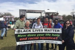 """Attendees of the Rally to End Racism display a """"Black Lives Matter"""" banner. (WTOP/Kristi King)"""
