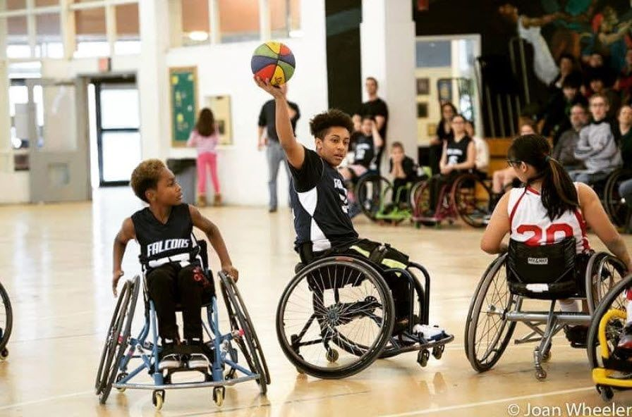 Kidus Ali (center) is the point guard for the Fairfax Falcons wheelchair basketball team, headed to nationals next week. (Courtesy: Joan Wheeler Photography)