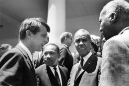 Attorney General Robert F. Kennedy talks with civil rights leaders on the White House grounds, June 22, 1963. From left: Kennedy; Rev. Martin Luther King, head of the Southern Christian Leadership Conference; Roy Wilkins, executive secretary of the NAACP, and A. Phillip Randolph, president, Brotherhood of Sleeping Car Porters. Joseph Rauh, civil rights lawyer, is in background at center. (AP Photo/Bob Schutz)
