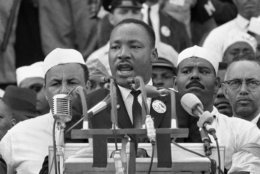 """FILE- In this Aug. 28, 1963, black-and-white file photo Dr. Martin Luther King Jr. addresses marchers during his """"I Have a Dream"""" speech at the Lincoln Memorial in Washington. (AP Photo/File)"""