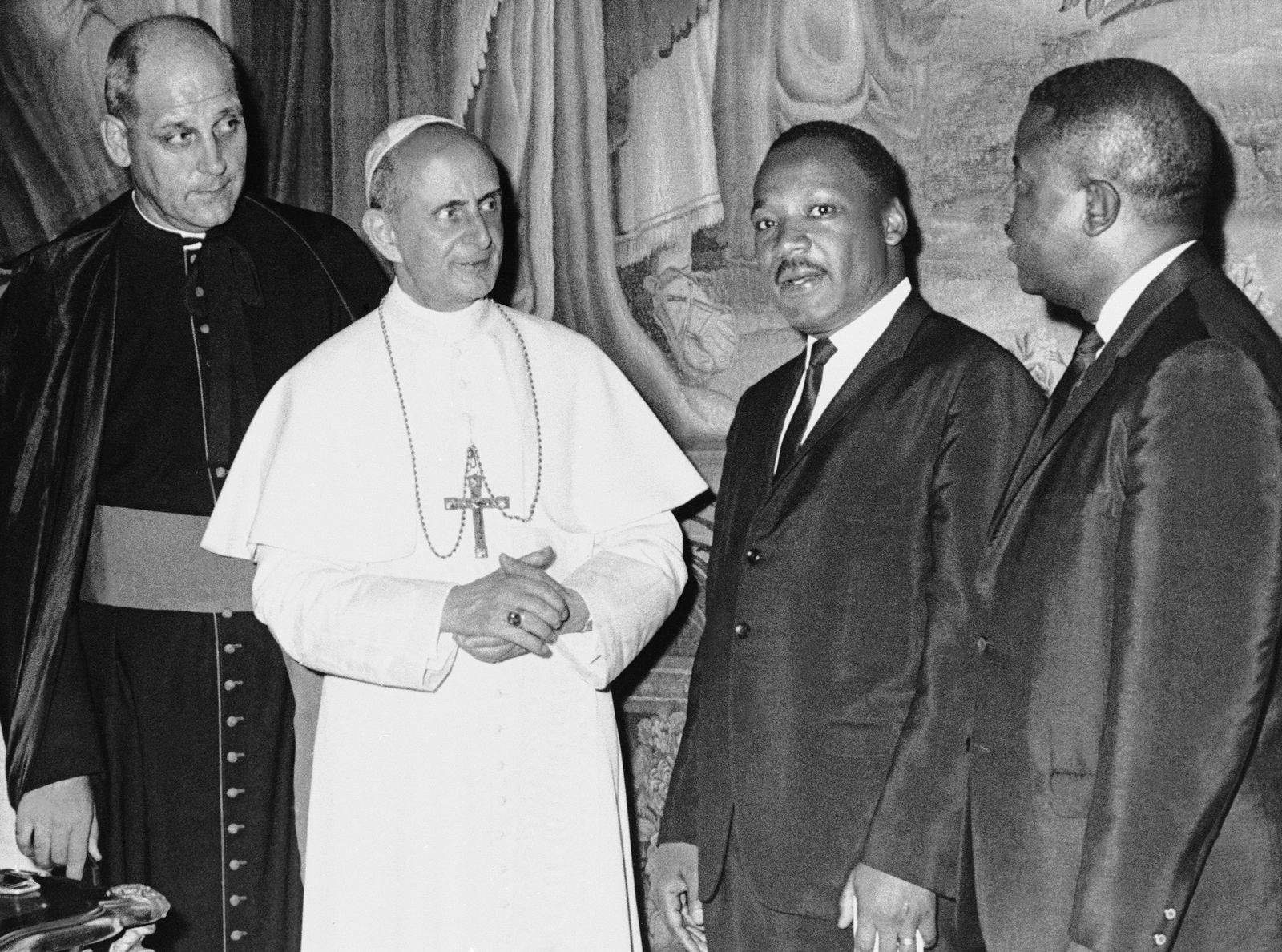 In his photo released by the Vatican, Pope Paul VI poses at the Vatican with American civil rights leader Dr. Martin Luther King, Jr., during a private audience, Sept. 18, 1964.  With the pontiff and King are Msgr. Paolo Marcinkus of Chicago, who acted as interpreter, and with King is his aide, Dr. Ralph Abernathy, right. (AP Photo/Vatican Photo)
