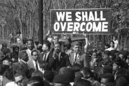 The Rev. Martin Luther King, integration leader, addresses a crowd on a street in Lakeview, New York May 12, 1965. The Nobel Prize winner arrived in the day from Atlanta, Ga., for a whirlwind tour of Nassau County to advance the cause of African Americans in that area. (AP Photo)