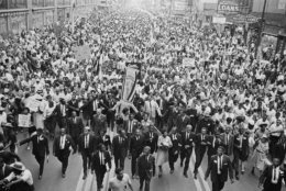 Rev. Martin Luther King Jr., center foreground, walks in vanguard of crowd estimated at more than 10,000 persons who gathered in downtown Chicago, July 26, 1965 to protest segregation in the city's schools. (AP Photo)