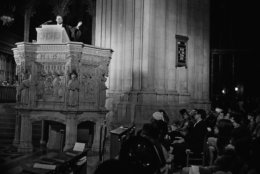 FILE - In this March 31, 1968 file photo, the Rev. Martin Luther King Jr., left, who heads the Southern Christian Leadership Conference, preaches to a capacity crowd from the pulpit at the National Cathedral in Washington. King spoke from the Cathedral's Canterbury Pulpit. It would be his last Sunday sermon before he was assassinated on April 4, 1968, in Memphis. (AP Photo/John Rous, File)