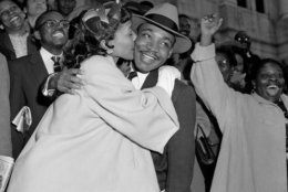 FILE - In this March 22, 1956, file photo, the Rev. Martin Luther King Jr. is welcomed with a kiss by his wife, Coretta, after leaving court in Montgomery, Ala. King was found guilty of conspiracy to boycott city buses in a campaign to desegregate the bus system, but a judge suspended his $500 fine pending appeal. (AP Photo/Gene Herrick, File)