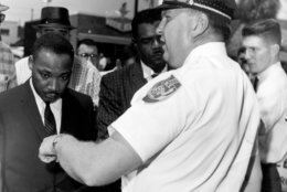 FILE - In this July 27, 1962 file photo, the Rev. Dr. Martin Luther King, Jr., is arrested by Albany's Chief of Police Laurie Pritchett after praying at City Hall in Albany, Ga. King participated in a month's long campaign of local anti-segregation led by the Southern Christian Leadership Conference. (AP Photo, File)