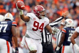 AUBURN, AL - NOVEMBER 25:  Da'Ron Payne #94 of the Alabama Crimson Tide reacts after recovering a fumble during the first quarter against the Auburn Tigers at Jordan Hare Stadium on November 25, 2017 in Auburn, Alabama.  (Photo by Kevin C. Cox/Getty Images)