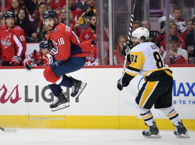 Penguins Capitals Hockey 44909 Washington Capitals center Chandler  Stephenson (18) leaps next to Pittsburgh Penguins right wing Phil Kessel  (81) during the ... 9bd557dc2ac