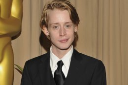 """FILE - In this March 7, 2010, file photo, Macaulay Culkin poses backstage during the 82nd Academy Awards in the Hollywood section of Los Angeles. Culkin says he avoids watching his """"Home Alone"""" movie. Appearing Monday, April 23, 2018, in a taped segment on """"The Ellen DeGeneres Show,"""" the actor jokes fans often ask him to recreate his face from the 1990 film and he won't oblige. (AP Photo/Vince Bucci, File)"""