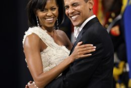 This Jan. 20, 2009 file photo shows President Barack Obama and first lady Michelle Obama at the Obama Home States Inaugural Ball in Washington. The two Harvard Law School grads met at the Chicago corporate law firm Sidley & Austin when Michelle was 25 and assigned as mentor to the 27-year-old Barack, a summer associate. (AP Photo/Charlie Neibergall, File)