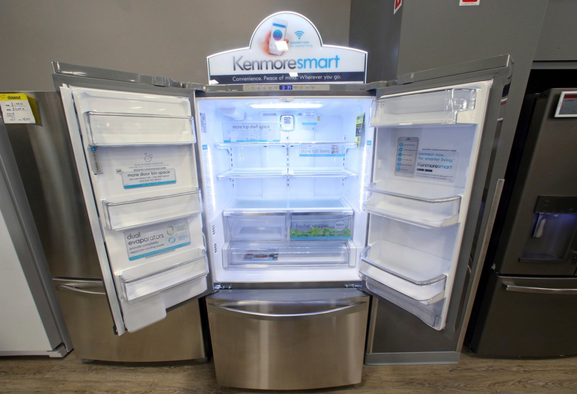 FILE - In this July 20, 2017, file photo, the Kenmore Elite Smart French Door Refrigerator appears on display at a Sears store in West Jordan, Utah. Private equity firm ESL Investments is offering to buy struggling Sear's Kenmore brand and home improvement unit. (AP Photo/Rick Bowmer, File)