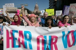 """ADVANCE FOR USE WEDNESDAY, APRIL 11, 2018 AT 3:01 A.M. EDT AND THEREAFTER-FILE - In this Saturday, Jan. 21, 2017 file photo, former Texas State Sen. Wendy Davis, center, dressed in all pink, leads the Women's March in Austin, Texas. Davis, who now runs the Austin-based women's advocacy group Deeds Not Words, recalls being touched """"very inappropriately"""" by a newly elected House member at a 2009 social gathering for lawmakers. She never filed a complaint and wasn't even aware there was a process for doing so. Often the fear of coming forward and what the consequence of that will look like suppresses anyone from saying anything,"""" she says. (Ralph Barrera/Austin American-Statesman via AP)"""
