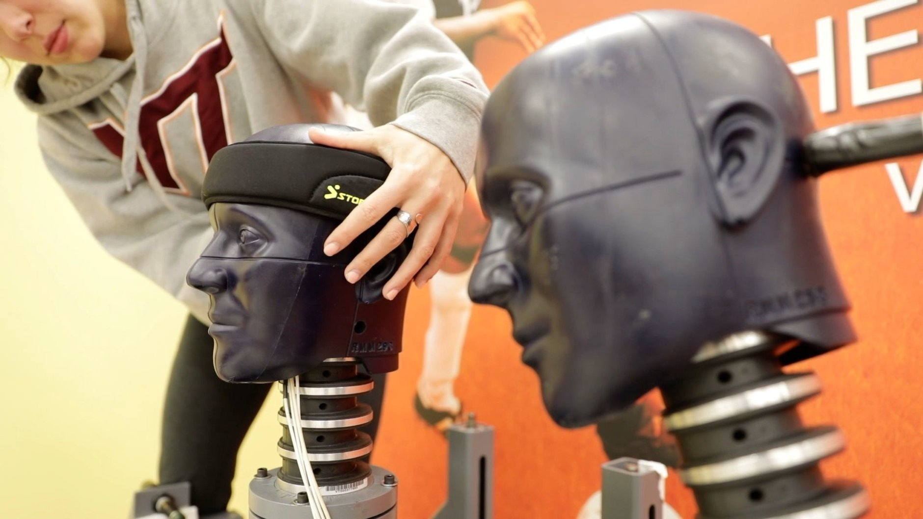 Sensors embedded in the dummy's heads measured linear and rotational acceleration for the calculation of a STAR rating, which represents how much the equipment reduced a player's risk of concussion for a given impact. (Courtesy Virginia Tech)