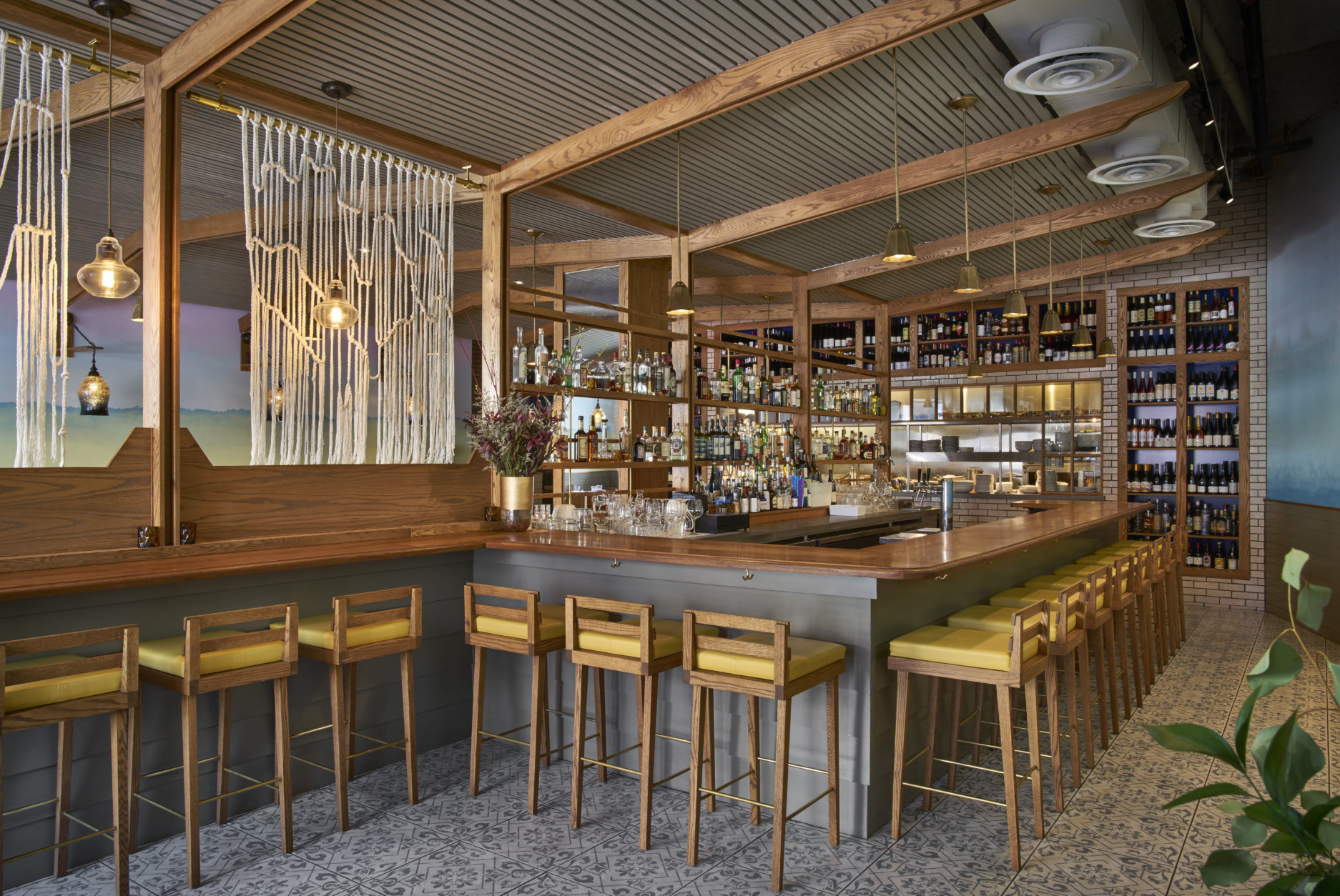 Streetsense's approach to Tail Up Goat (1827 Adams Mill Road NW) gives a nod to co-owner Jill Tyler's origins in the U.S. Virgin Islands. Cheery hues and seascape-inspired murals ensure a breezy ambience. (Courtesy Streetsense/Greg Powers)