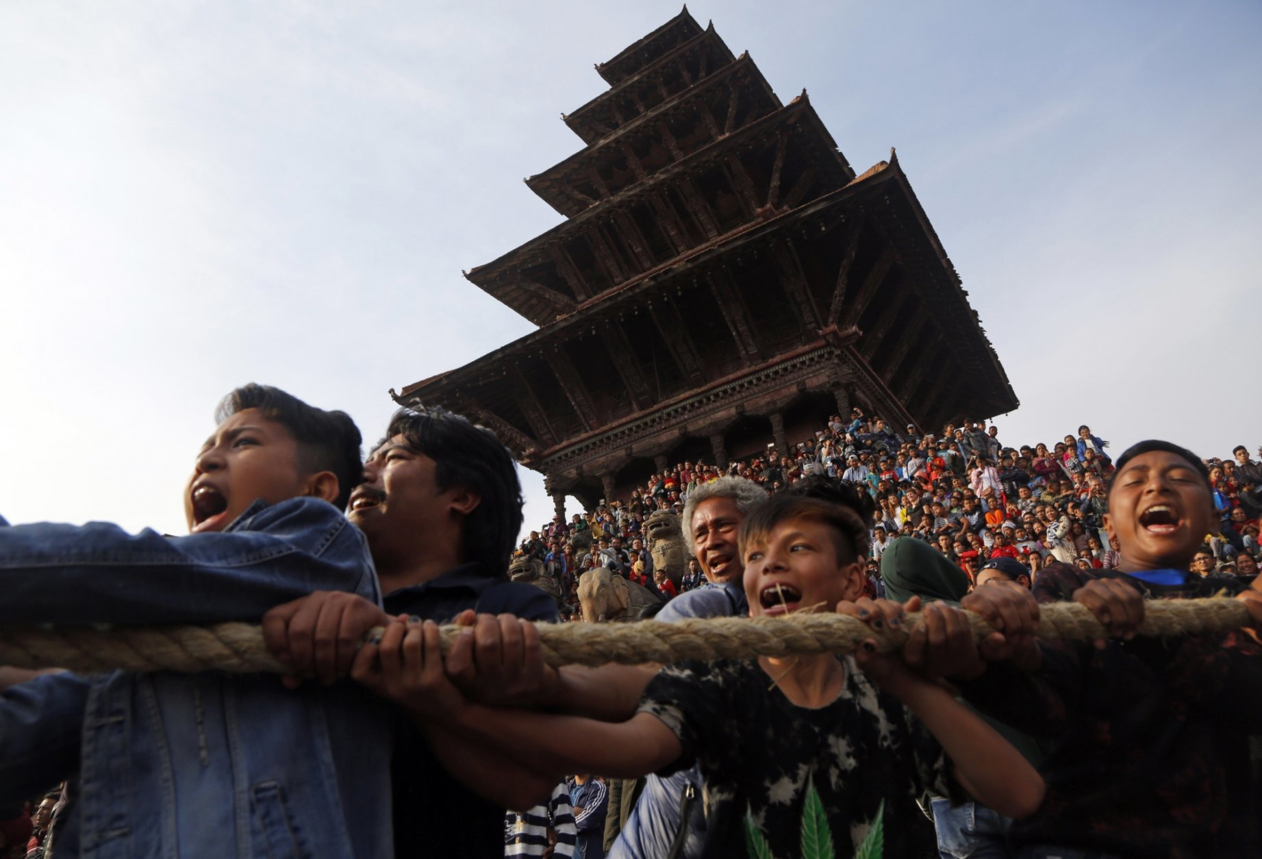 In this April 10, 2018 photo, Nepalese devotees pull ropes tied to the chariot of Hindu god Bhairava during Biska Jatra Festival in Bhaktapur, Nepal, Tuesday, April 10, 2018. During the festival, also regarded as Nepalese New Year, images of Hindu god Bhairava and his female counterpart Bhadrakali are enshrined in two large chariots and pulled to an open square after which rituals and festivities are performed. (AP Photo/Niranjan Shrestha, File)