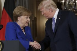 President Donald Trump shakes hands with German Chancellor Angela Merkel during a news conference in the East Room of the White House, Friday, April 27, 2018, in Washington. (AP Photo/Evan Vucci)