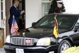 President Donald Trump claps as the car with German Chancellor Angela Merkel arrives Friday April 27, 2018, at the White House in Washington. (AP Photo/Jacquelyn Martin)