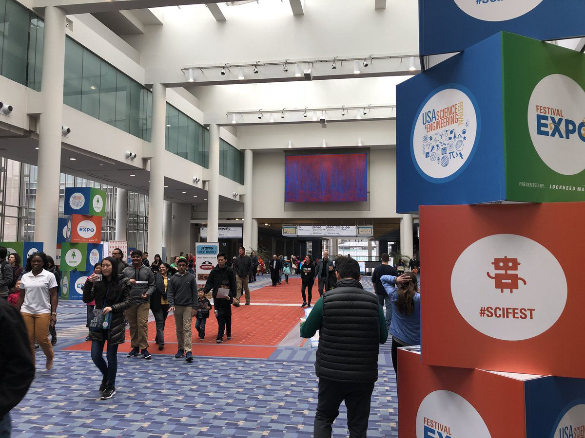 People arrive at the USA Science and Engineering Expo at the Washington Convention Center (WTOP/Melissa Howell)