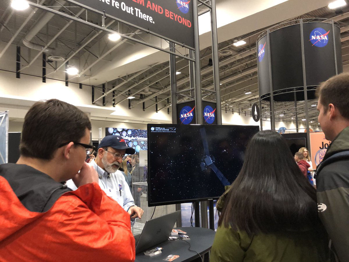 Students at an exhibit presented by NASA at the Science and Engineering Fest. (WTOP/Melissa Howell)