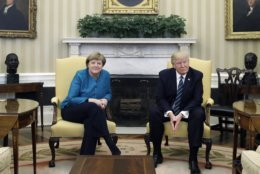 FILE - In this March 17, 2017 file photo President Donald Trump and German Chancellor Angela Merkel meet in the Oval Office of the White House in Washington. Merkel is traveling to Washington to meet with Trump on Friday, April 27, 2018. (AP Photo/Evan Vucci, file)