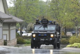 Metro Nashville Police bomb squad personnel arrive at Discovery at Mountain View Apartments Sunday, April 22, 2018 in Nashville, Tenn. At least four people died when a gunman opened fire at a nearby Waffle House restaurant earlier in the day. (Shelley Mays, The Tennessean via AP)