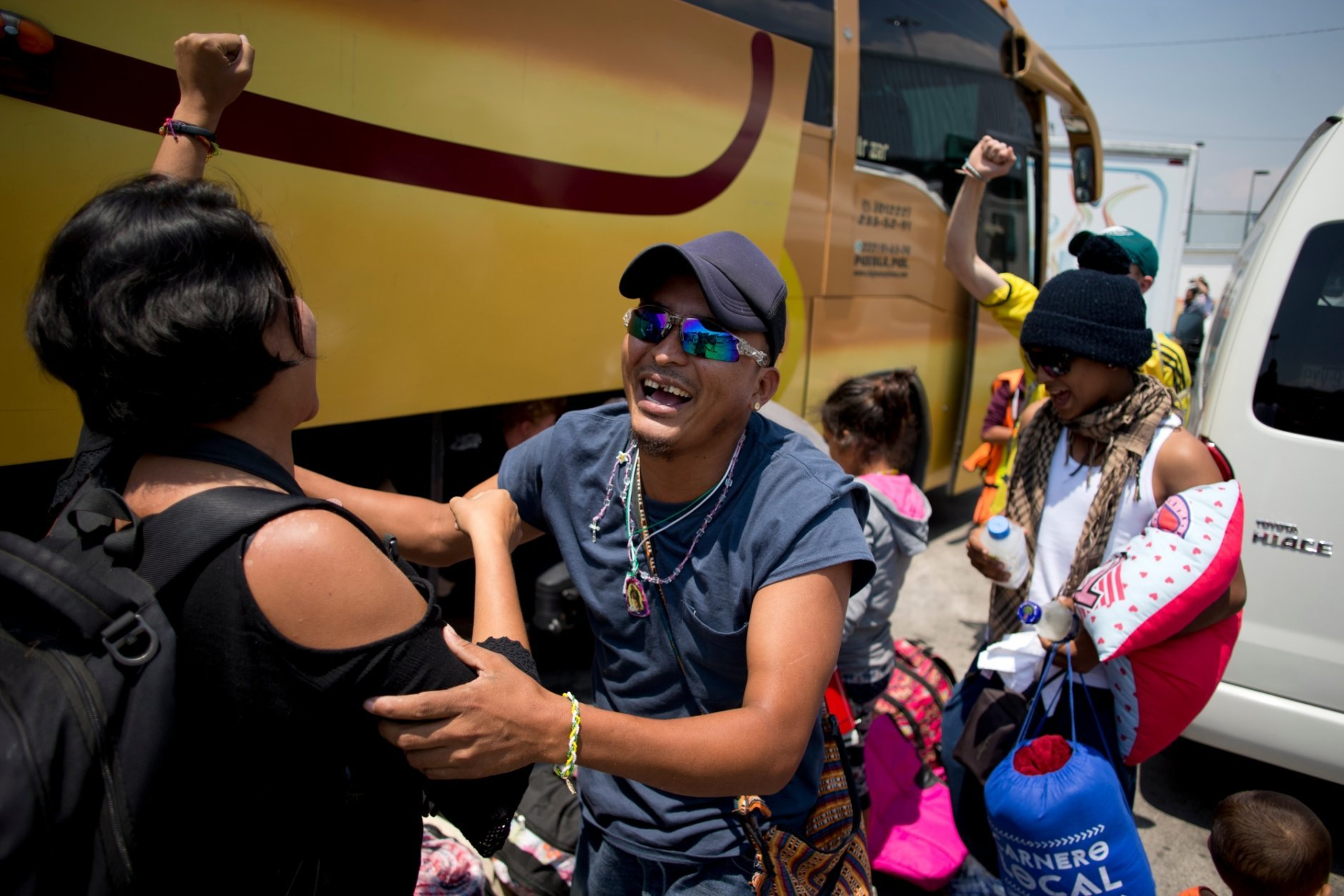 In this Monday, April 9, 2018 photo, Central American migrants who took part in the annual Migrants Stations of the Cross caravan are greeted upon arrival to a shelter in Mexico City. About 600 remaining participants in the migrant caravan that drew President Donald Trump's ire made their last stop Saturday in Mexico City to give thanks to the Virgin of Guadalupe. (AP Photo/Eduardo Verdugo)