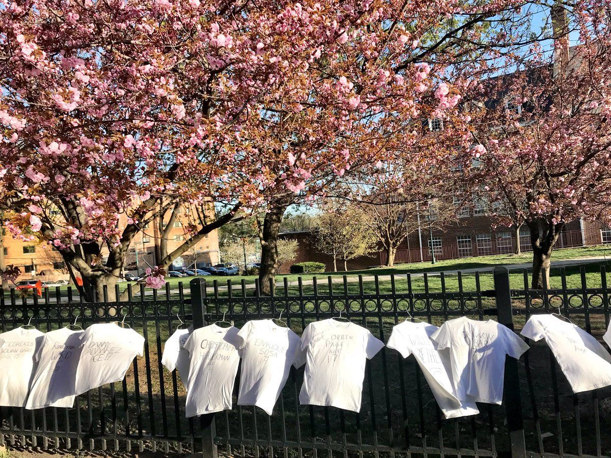 Students at Bethesda-Chevy Chase High School display 199 T-shirts at the school's fence to represent the teens killed by guns in 2018. (WTOP/Neal Augenstein)