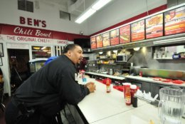 A D.C. Police officer places an order inside Ben's Chili Bowl, taking a break from the 10-hour training incorporating a tour of the U Street corridor and the restaurant integral to the history of the city. (Courtesy DC Police)