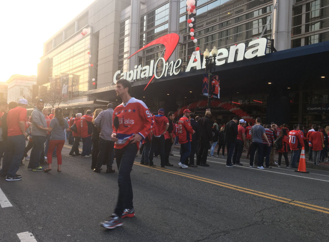 Fans gather outside the Capital One arena in Washington, D.C. during the first game of the first round of the Stanley Cup Playoffs between the Washington Capitals and the Columbus Blue Jackets, Thursday, April 12, 2018. (WTOP/Mike Murillo)