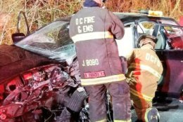 D.C. Fire and EMS are shown extricating victims from the crash on Clara Barton Parkway Sunday morning. (Courtesy D.C. Fire and EMS)