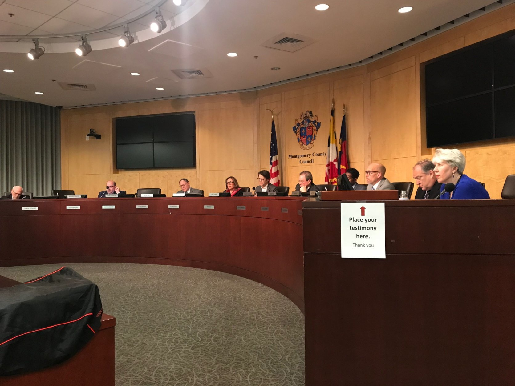 At a Montgomery County Council public hearing Tuesday night, some residents testified against a change to the zoning laws that would allow the antennas on utility poles and buildings near houses and schools. (WTOP/Dick Uliano)