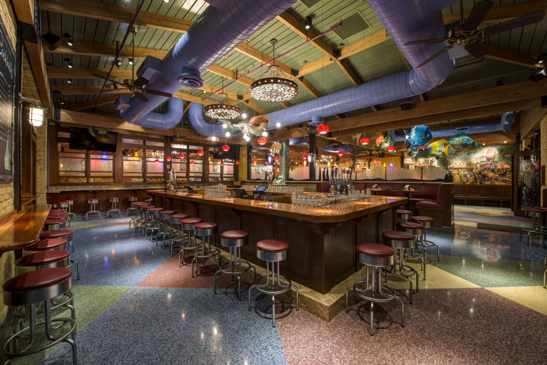 "Streetsense maintained the ""beach house fun"" vibe at Coastal Flats' third location in Gaithersburg (135 Crown Park Ave.) with custom murals and an open ceiling. (Courtesy Streetsense/Ira Wexler)"