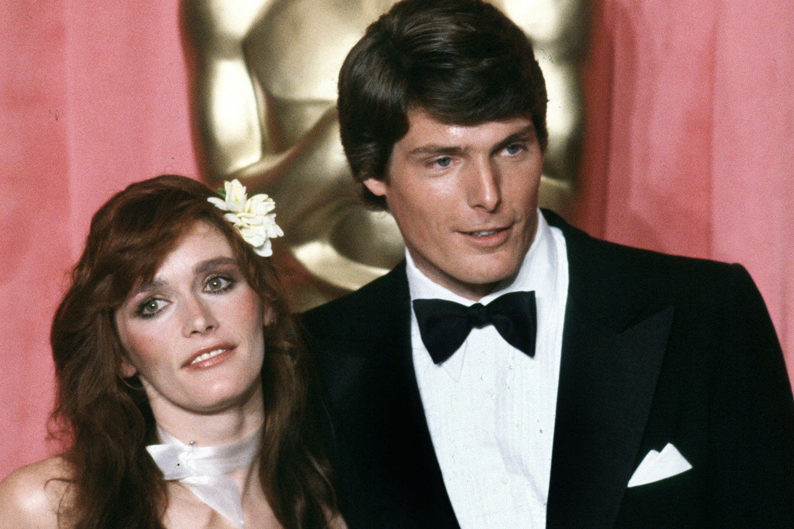"Actress Margot Kidder, left, and actor Christopher Reeve pose in front of Oscar at the 51st Annual Academy Awards ceremony in Los Angeles, Calif., April 9, 1979.  Kidder portrayed Lois Lane opposite Reeve in ""Superman. The Movie received an award for special achievement and received nominations for film editing, best original score and best original sound.""  (AP Photo/Reed Saxon)"