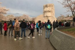 Visitors to the MLK, Jr. Memorial are discussing King's eloquence and ability to mobilize people of many backgrounds. (WTOP/Neal Augenstein)