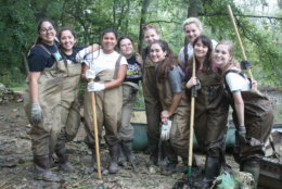 Young women help clean up Kenilworth Aquatic Gardens during 2016's National Public Lands Day.