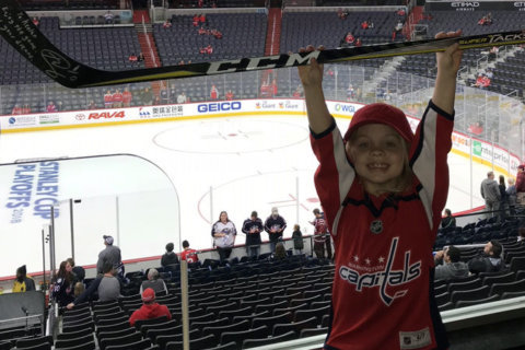 Young Caps fan in viral 'puck girl' video meets Ted Leonsis before Game 5