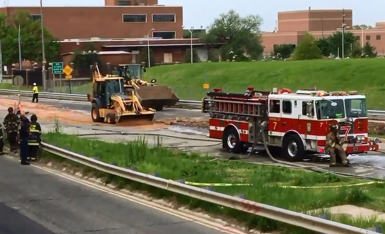 Crews hauled in sand to stop the spread of the spilled fuel. (Courtesy D.C. Fire and EMS)