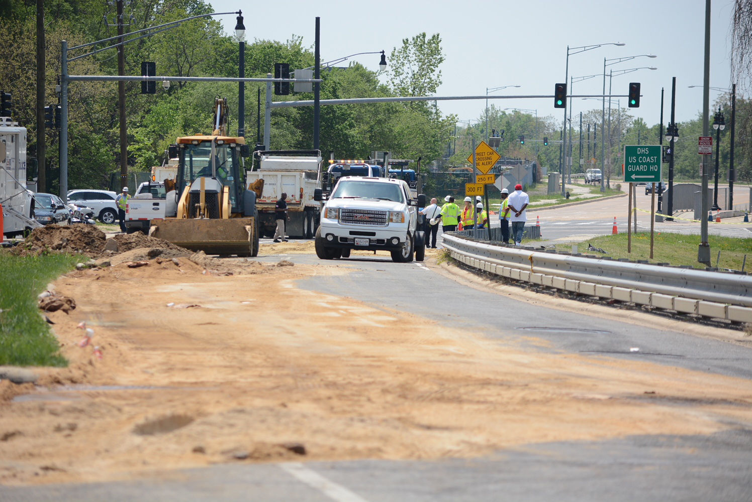 Crews hauled in sand to stop the spread of the spilled fuel. (WTOP/Dave Dildine)