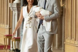"""Britain's Prince Harry and Meghan, Duchess of Sussex, arrive for a photocall with their newborn son, in St George's Hall at Windsor Castle, Windsor, south England, Wednesday May 8, 2019. Baby Sussex was born Monday at 5:26 a.m. (0426 GMT; 12:26 a.m. EDT) at an as-yet-undisclosed location. An overjoyed Harry said he and Meghan are """"thinking"""" about names. (Dominic Lipinski/Pool via AP)"""