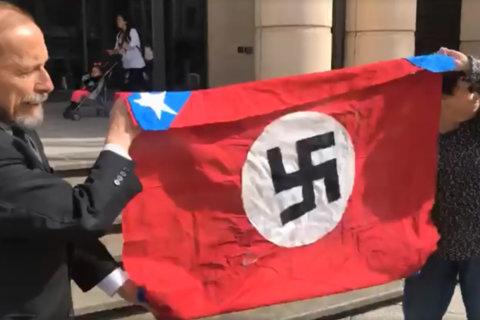 Activist gets OK to burn Confederate-Nazi flag in Leesburg