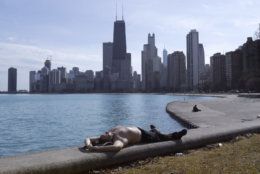 Johnny Perez suns himself in springlike temperatures along Lake Michigan at the North Ave., beach Tuesday, Feb. 27, 2018, in Chicago. (AP Photo/Charles Rex Arbogast)