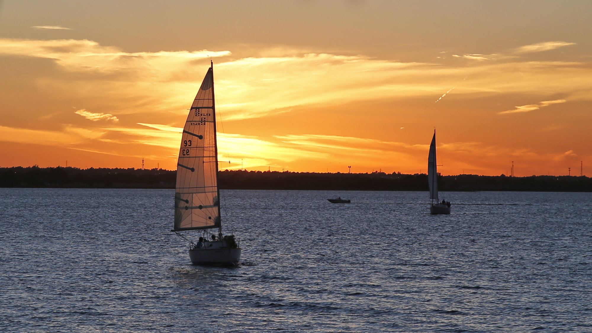 Sailboats return to the harbor as the sun sets at Lake Hefner in Oklahoma City, Wednesday, Sept. 28, 2016. (AP Photo/Sue Ogrocki)