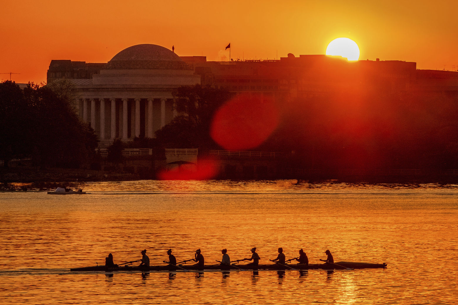 Rowers skim along the Potomac River as the sun rises over the Jefferson Memorial in Washington, Wednesday, May 2, 2018. The temperature in the Nation's Capitol is expected to reach into the upper 80's Wednesday as spring begins to give way to summer. (AP Photo/J. David Ake)