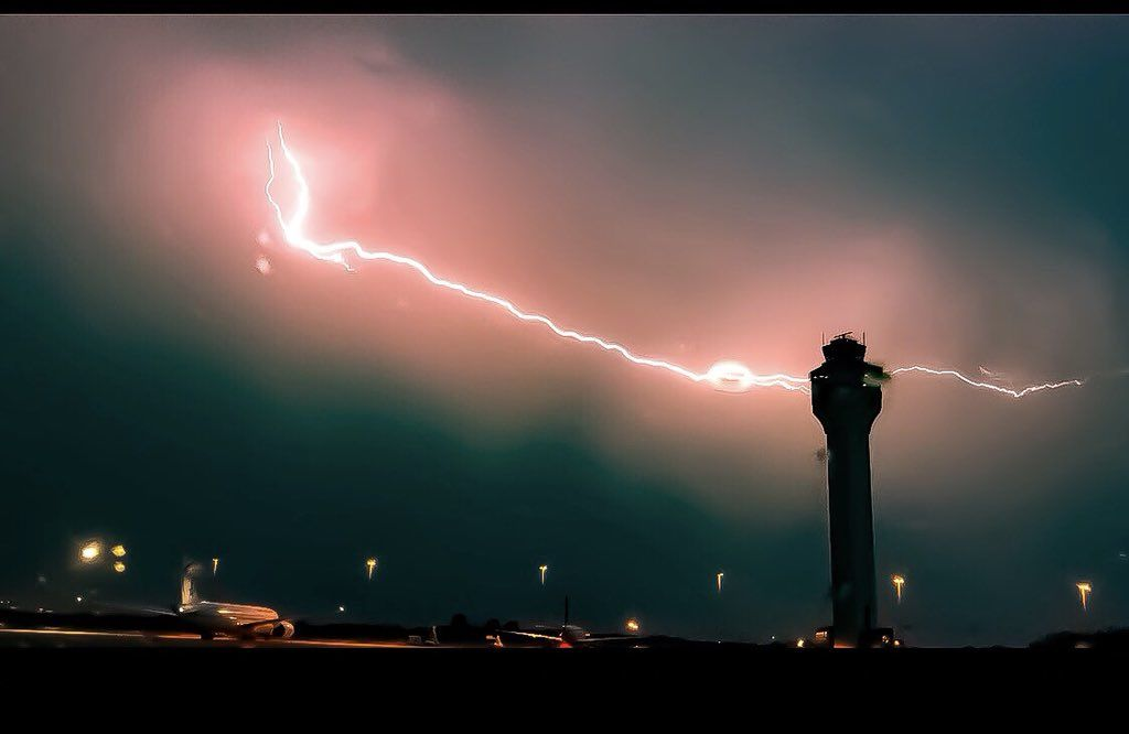 Lightning streaks across the sky at Dulles Airport. (Courtesy BDwy via Twitter)