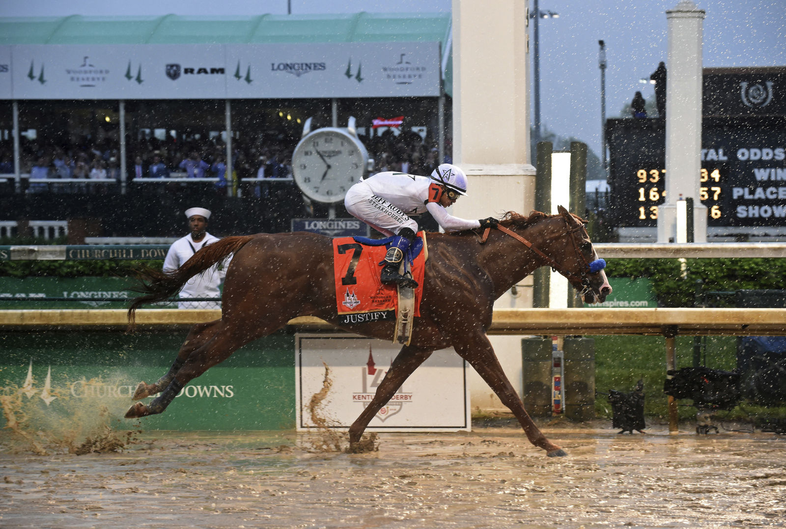 IMAGE DISTRIBUTED FOR LONGINES - Justify, ridden by jockey Mike Smith, wins the 144th Kentucky Derby, the wettest in history, on Saturday, May 5, 2018, at Churchill Downs in Louisville, Ky. Longines, the Swiss watch manufacturer known for its luxury timepieces, is the Official Watch and Timekeeper of the 144th annual Kentucky Derby. (Photo by Diane Bondareff/Invision for Longines/AP Images)