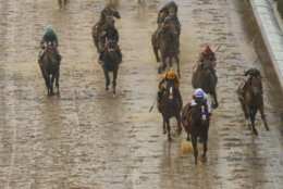 Mike Smith rides Justify to victory during the 144th running of the Kentucky Derby horse race at Churchill Downs Saturday, May 5, 2018, in Louisville, Ky. (AP Photo/Charlie Riedel)