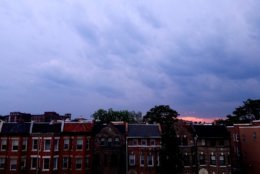 Dark clouds roll in over D.C.'s Columbia Heights neighborhood Tuesday evening. (WTOP/Will Vitka)